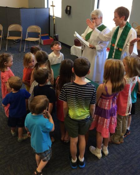 Celebrating the Eucharist at the August Comfy Space service
