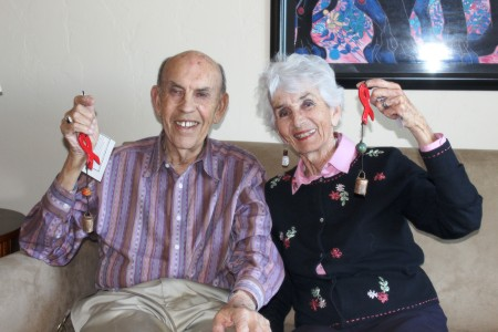 Noel Matkin and Ann Baldwin, with their special-edition Ben's Bells, hand-painted by people living with HIV with gratitude for these caring and generous ambassadors